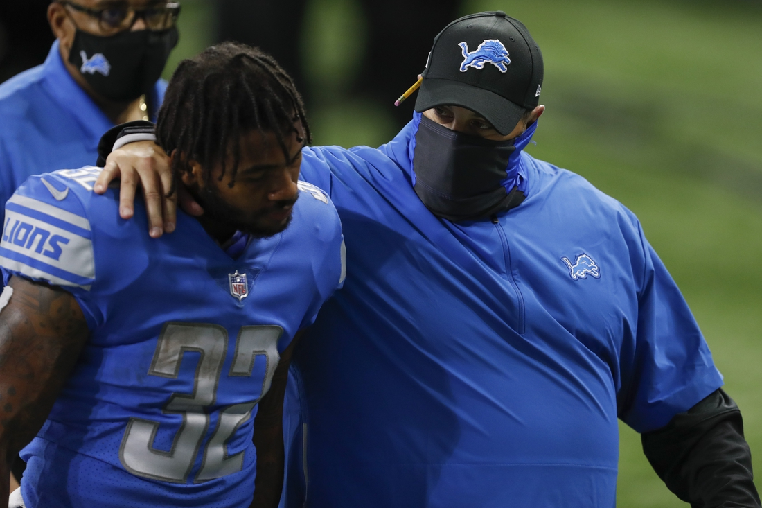 Sep 13, 2020; Detroit, Michigan, USA; Detroit Lions head coach Matt Patricia tries to console running back D'Andre Swift (32) after the game against the Chicago Bears at Ford Field. Mandatory Credit: Raj Mehta-USA TODAY Sports
