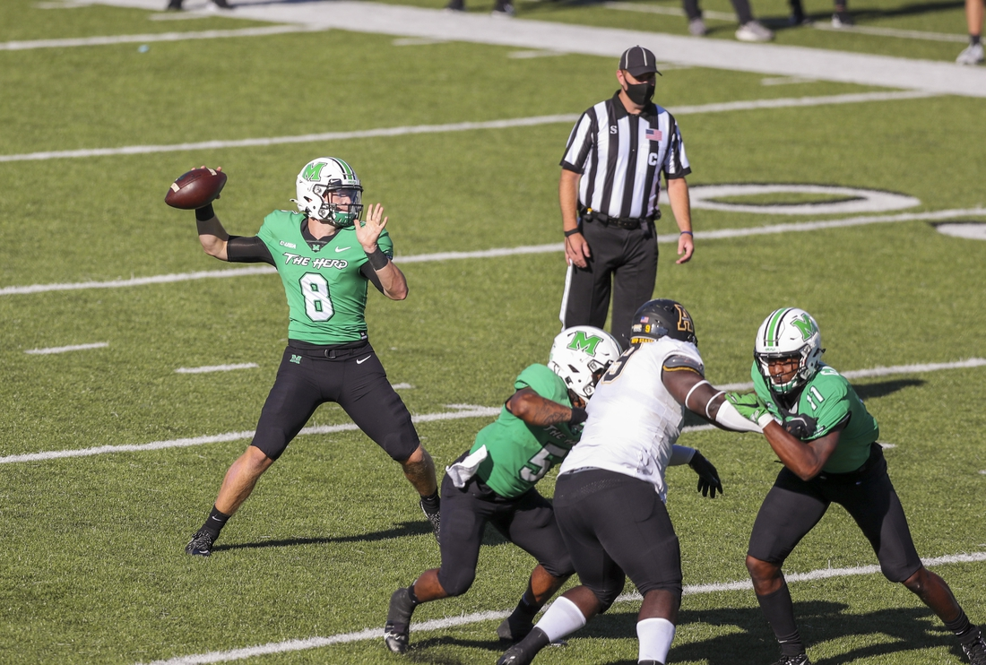 Sep 19, 2020; Huntington, West Virginia, USA; Marshall Thundering Herd quarterback Grant Wells (8) throws a pass during the second quarter against the Appalachian State Mountaineers at Joan C. Edwards Stadium. Mandatory Credit: Ben Queen-USA TODAY Sports