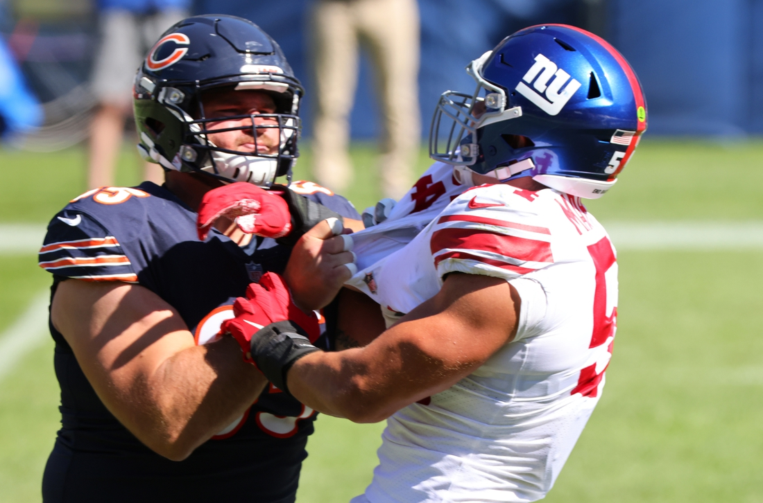 Sep 20, 2020; Chicago, Illinois, USA; Chicago Bears center Cody Whitehair (65) and New York Giants inside linebacker Blake Martinez (54) get into a scuffle during the third quarter at Soldier Field. Mandatory Credit: Mike Dinovo-USA TODAY Sports