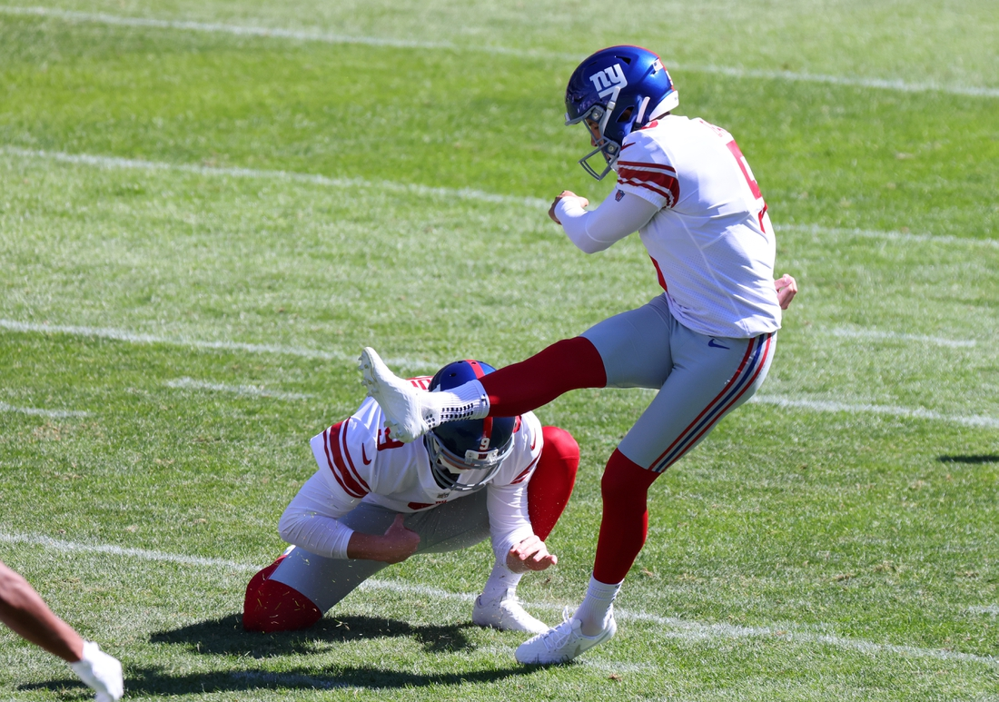 Sep 20, 2020; Chicago, Illinois, USA; New York Giants kicker Graham Gano (5) kick a field goal against the Chicago Bears during the third quarter at Soldier Field. Mandatory Credit: Mike Dinovo-USA TODAY Sports