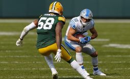 Sep 20, 2020; Green Bay, Wisconsin, USA;  Detroit Lions wide receiver Danny Amendola (80) rushes with the football after catching a pass as Green Bay Packers outside linebacker Christian Kirksey (58) defends during the fourth quarter at Lambeau Field. Mandatory Credit: Jeff Hanisch-USA TODAY Sports