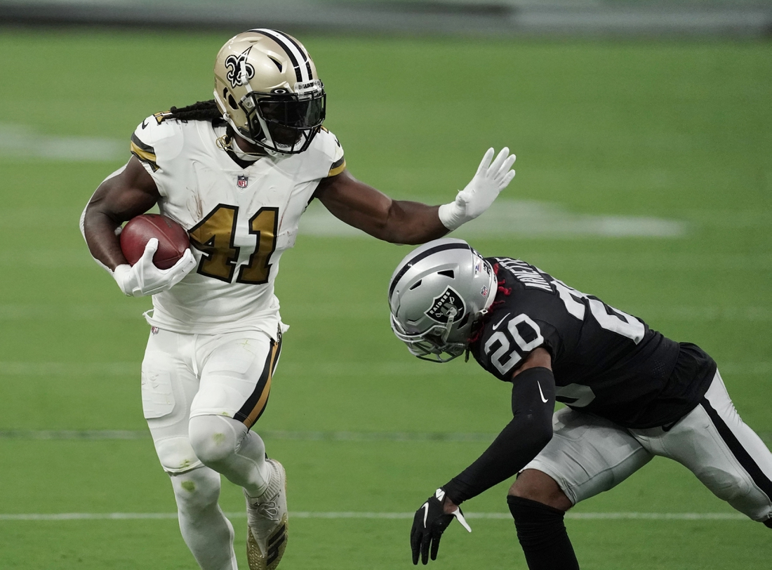 Sep 21, 2020; Paradise, Nevada, USA;  New Orleans Saints running back Alvin Kamara (41) runs the ball against Las Vegas Raiders cornerback Damon Arnette (20) during the first quarter of a NFL game at Allegiant Stadium. Mandatory Credit: Kirby Lee-USA TODAY Sports