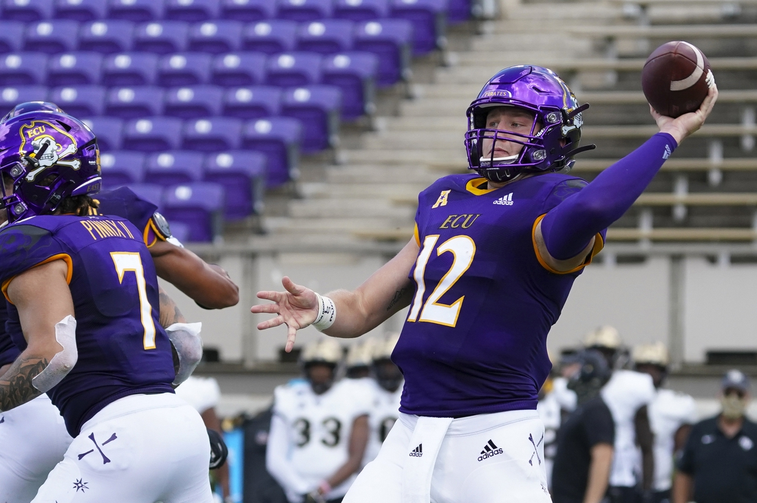 Sep 26, 2020; Greenville, North Carolina, USA;  East Carolina Pirates quarterback Holton Ahlers (12) throws the ball during the first half against the UCF Knights at Dowdy-Ficklen Stadium. Mandatory Credit: James Guillory-USA TODAY Sports