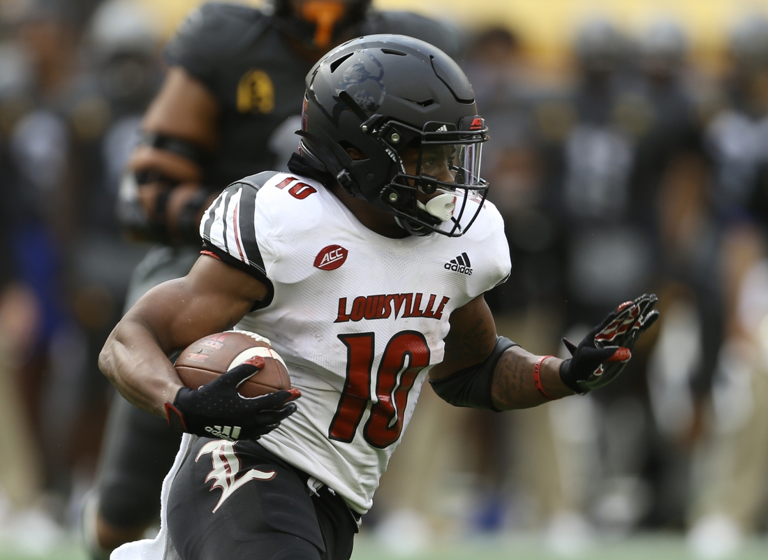 Sep 26, 2020; Pittsburgh, Pennsylvania, USA;  Louisville Cardinals running back Javian Hawkins (10) runs the ball against the Pittsburgh Panthers during the fourth quarter at Heinz Field. Pittsburgh won 23-20. Mandatory Credit: Charles LeClaire-USA TODAY Sports