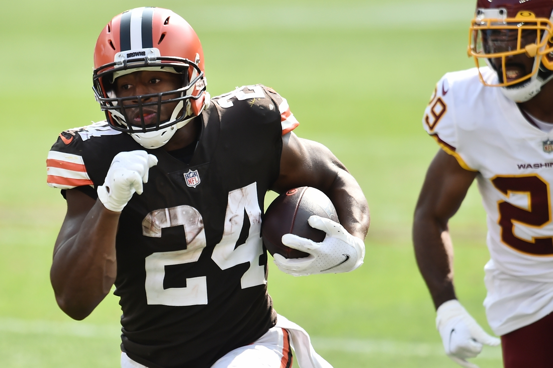 Sep 27, 2020; Cleveland, Ohio, USA; Cleveland Browns running back Nick Chubb (24) runs with the ball asWashington Football Team cornerback Kendall Fuller (29) defends during the second half at FirstEnergy Stadium. Mandatory Credit: Ken Blaze-USA TODAY Sports