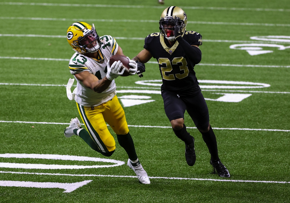 Sep 27, 2020; New Orleans, Louisiana, USA; Green Bay Packers wide receiver Allen Lazard (13) catches a pass over New Orleans Saints cornerback Marshon Lattimore (23) during the second quarter at the Mercedes-Benz Superdome. Mandatory Credit: Derick E. Hingle-USA TODAY Sports