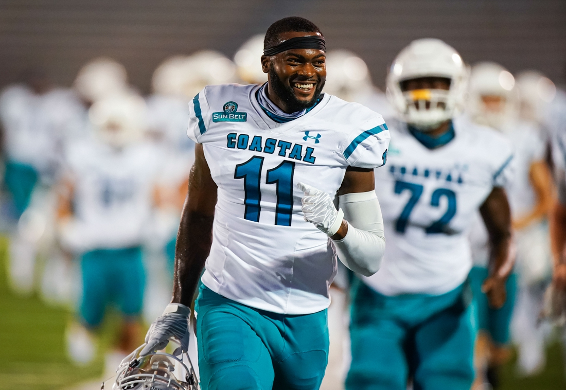 Sep 12, 2020; Lawrence, Kansas, USA; Coastal Carolina Chanticleers wide receiver Kameron Brown (11) takes the field before the game against the Kansas Jayhawks at David Booth Kansas Memorial Stadium. Mandatory Credit: Jay Biggerstaff-USA TODAY Sports
