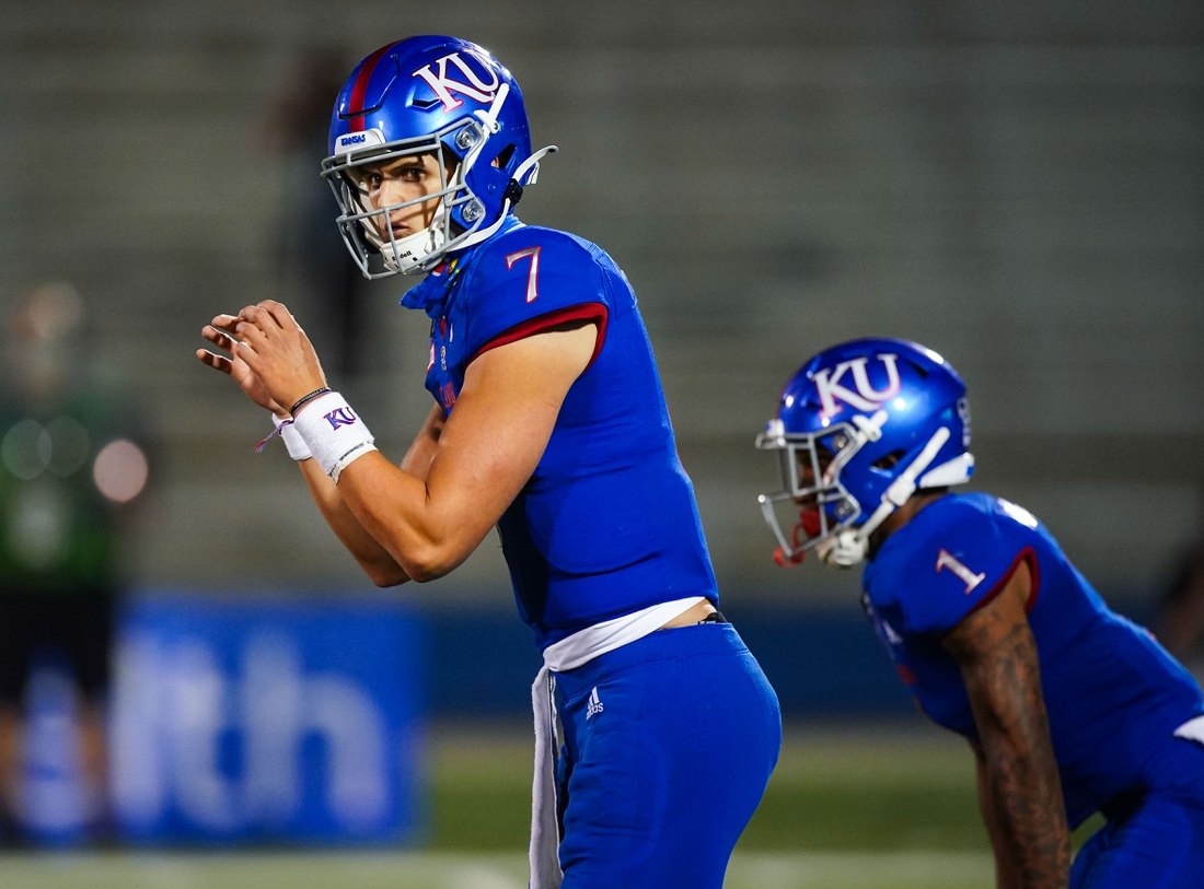 Sep 12, 2020; Lawrence, Kansas, USA; Kansas Jayhawks quarterback Thomas MacVittie (7) checks the defense before the snap against the Coastal Carolina Chanticleers at David Booth Kansas Memorial Stadium. Mandatory Credit: Jay Biggerstaff-USA TODAY Sports