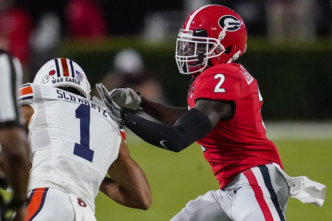 Oct 3, 2020; Athens, Georgia, USA; Georgia Bulldogs defensive back Richard LeCounte (2) pushes Auburn Tigers wide receiver Anthony Schwartz (1) out of bounds during the first half at Sanford Stadium. Mandatory Credit: Dale Zanine-USA TODAY Sports