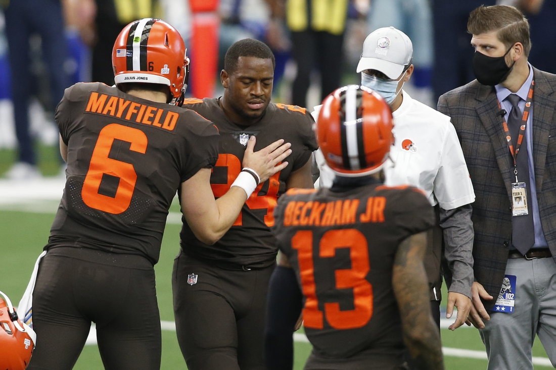 Oct 4, 2020; Arlington, Texas, USA; Cleveland Browns running back Nick Chubb (24) leaves the field with an injury as quarterback Baker Mayfield (6) talks to him in the first quarter against the Dallas Cowboys at AT&T Stadium. Mandatory Credit: Tim Heitman-USA TODAY Sports
