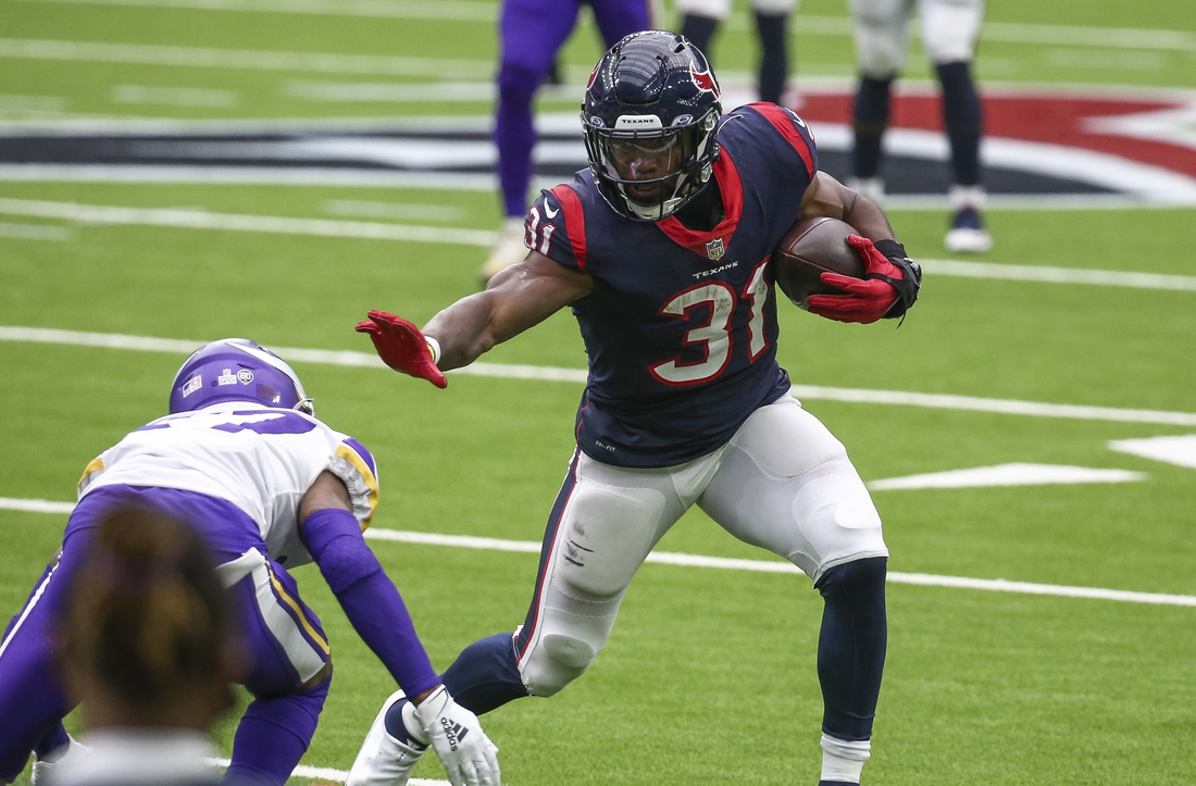Oct 4, 2020; Houston, Texas, USA; Houston Texans running back David Johnson (31) runs the ball against the Minnesota Vikings during the fourth quarter at NRG Stadium. Mandatory Credit: Troy Taormina-USA TODAY Sports