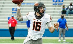 Oct 3, 2020; Lawrence, Kansas, USA; Oklahoma State Cowboys quarterback Shane Illingworth (16) throws a pass against the Kansas Jayhawks during the first half at David Booth Kansas Memorial Stadium. Mandatory Credit: Jay Biggerstaff-USA TODAY Sports