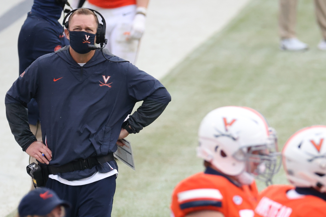 Oct 10, 2020; Charlottesville, Virginia, USA; Virginia Cavaliers head coach Bronco Mendenhall (L) stands on the sidelines during a timeout against the North Carolina State Wolfpack in the second quarter at Scott Stadium. Mandatory Credit: Geoff Burke-USA TODAY Sports