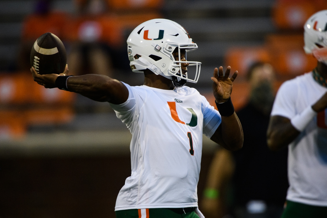 Oct 10, 2020; Clemson, South Carolina, USA; Miami Hurricanes quarterback D'Eriq King(1) runs through warmup drills before a game against the Clemson Tigers at Memorial Stadium. Mandatory Credit: Ken Ruinard-USA TODAY Sports
