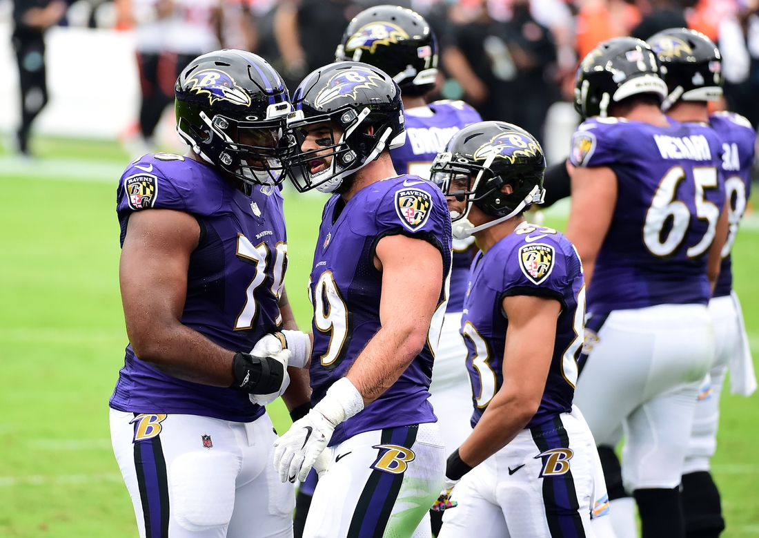 Oct 11, 2020; Baltimore, Maryland, USA; Baltimore Ravens tight end Mark Andrews (89) celebrates with offensive tackle Ronnie Stanley (79) after scoring a touchdown in the first quarter against the Cincinnati Bengals at M&T Bank Stadium. Mandatory Credit: Evan Habeeb-USA TODAY Sports