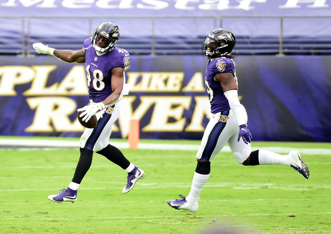 Oct 11, 2020; Baltimore, Maryland, USA; Baltimore Ravens linebacker Patrick Queen (48) celebrates with linebacker Matthew Judon (99) after recovering a fumble in the second quarter against the Cincinnati Bengals at M&T Bank Stadium. Mandatory Credit: Evan Habeeb-USA TODAY Sports