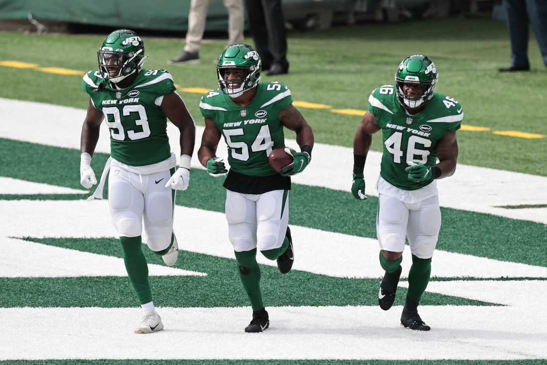 Oct 11, 2020; East Rutherford, New Jersey, USA; New York Jets inside linebacker Avery Williamson (54) celebrates his interception with outside linebacker Tarell Basham (93) and linebacker Neville Hewitt (46) against the Arizona Cardinals during the first half at MetLife Stadium. Mandatory Credit: Vincent Carchietta-USA TODAY Sports