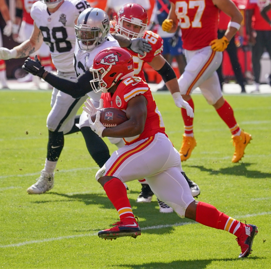Oct 11, 2020; Kansas City, Missouri, USA; Kansas City Chiefs running back Clyde Edwards-Helaire (25) runs the ball as Las Vegas Raiders defensive tackle Daniel Ross (93) chases during the game at Arrowhead Stadium. Mandatory Credit: Denny Medley-USA TODAY Sports