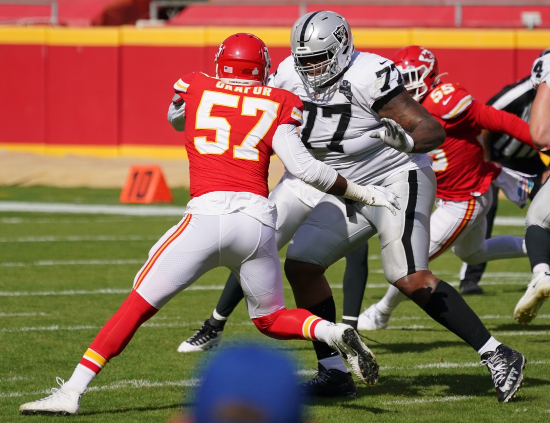 Oct 11, 2020; Kansas City, Missouri, USA; Kansas City Chiefs defensive end Alex Okafor (57) blocks Las Vegas Raiders offensive tackle Trent Brown (77) during the game at Arrowhead Stadium. Mandatory Credit: Denny Medley-USA TODAY Sports