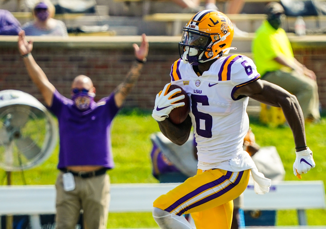 Oct 10, 2020; Columbia, Missouri, USA; LSU Tigers wide receiver Terrace Marshall Jr. (6) runs for a touchdown against the Missouri Tigers during the second half at Faurot Field at Memorial Stadium. Mandatory Credit: Jay Biggerstaff-USA TODAY Sports