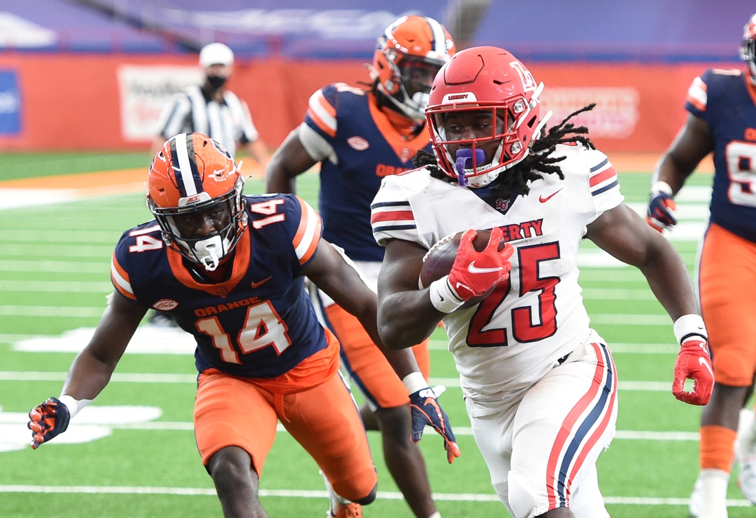 Oct 17, 2020; Syracuse, NY, USA;  Liberty Flames running back Peytton Pickett (25) runs for a touchdown in the second half during a game against Syracuse on Saturday, Oct. 17, 2020, at the Carrier Dome in Syracuse, N.Y.  Mandatory Credit: Dennis Nett/Pool Photo-USA TODAY Sports