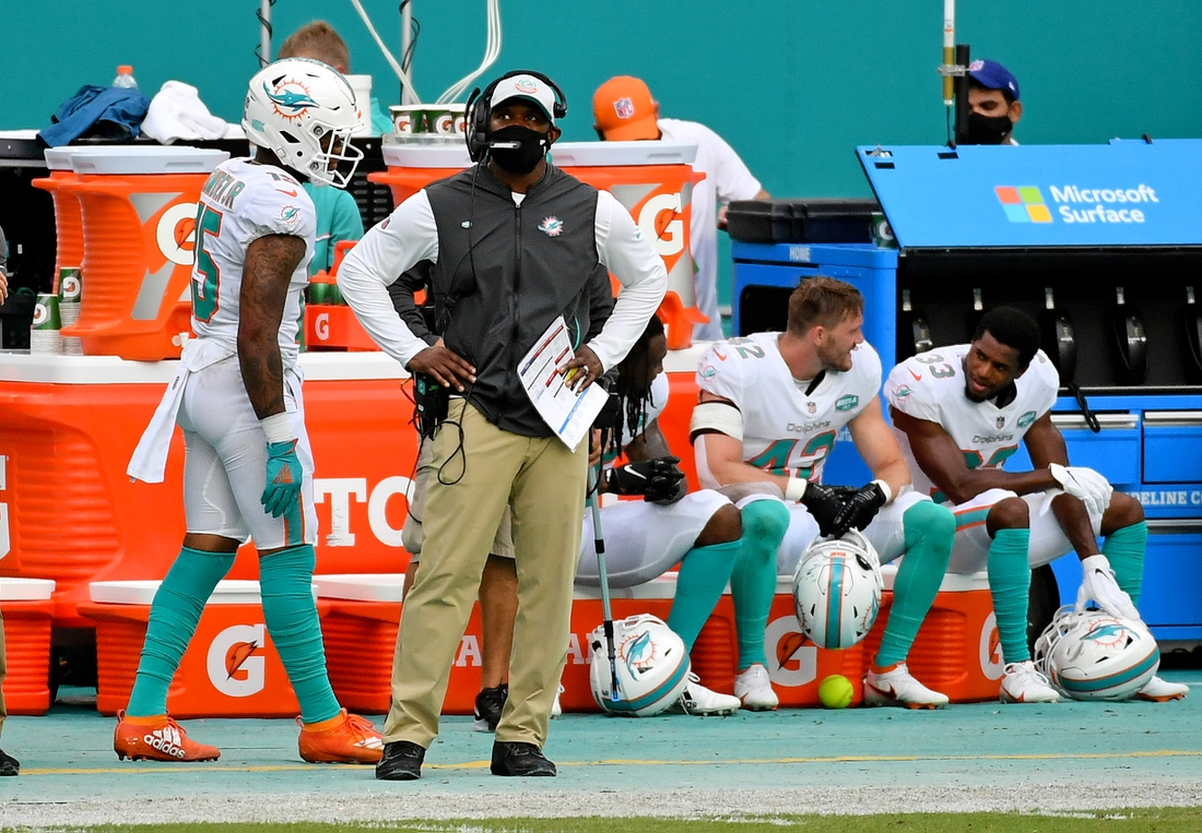 Oct 18, 2020; Miami Gardens, Florida, USA; Miami Dolphins head coach Brian Flores looks on during the first half against the New York Jets at Hard Rock Stadium. Mandatory Credit: Jasen Vinlove-USA TODAY Sports