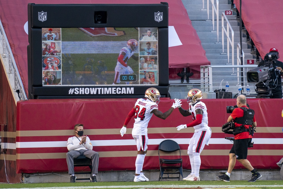 October 18, 2020; Santa Clara, California, USA; San Francisco 49ers wide receiver Deebo Samuel (19) is congratulated by wide receiver Kendrick Bourne (84) for scoring a touchdown against the Los Angeles Rams during the first quarter at Levi's Stadium. Mandatory Credit: Kyle Terada-USA TODAY Sports