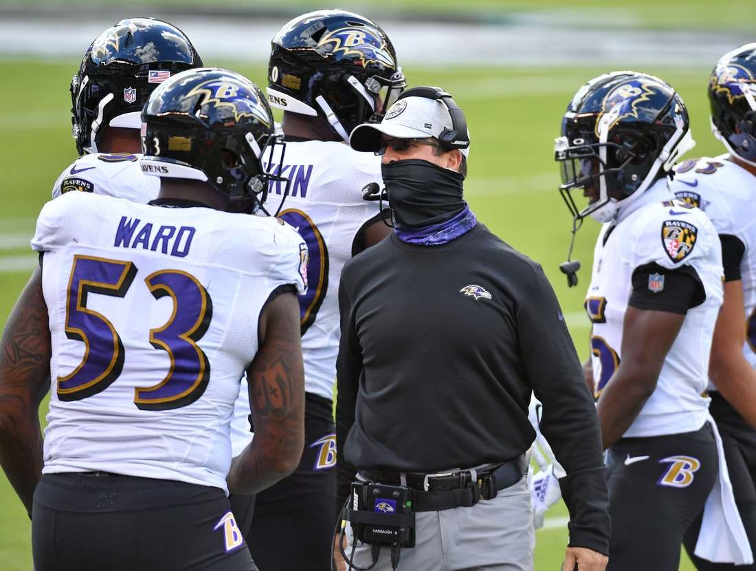 Oct 18, 2020; Philadelphia, Pennsylvania, USA; Baltimore Ravens head coach John Harbaugh talks with defensive end Jihad Ward (53) against the Philadelphia Eagles  at Lincoln Financial Field. Mandatory Credit: Eric Hartline-USA TODAY Sports