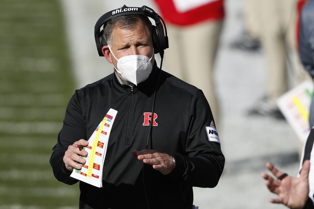 Oct 24, 2020; East Lansing, Michigan, USA; Rutgers Scarlet Knights head coach Greg Schiano prepares to call a time out during the fourth quarter against the Michigan State Spartans at Spartan Stadium. Mandatory Credit: Raj Mehta-USA TODAY Sports