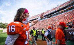Oct 24, 2020; Clemson, South Carolina, USA;   Clemson quarterback Trevor Lawrence (16) waves to fans after their game against Syracuse at Memorial Stadium. Mandatory Credit: Ken Ruinard-USA TODAY Sports