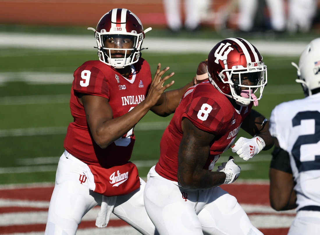Oct 24, 2020; Bloomington, Indiana, USA; Indiana Hoosiers quarterback Michael Penix Jr. (9) prepares to pass after a fake handoff to Indiana Hoosiers running back Stevie Scott III (8) during the first quarter of the game against the Penn State Nittany Lions at Memorial Stadium. Mandatory Credit: Marc Lebryk-USA TODAY Sports