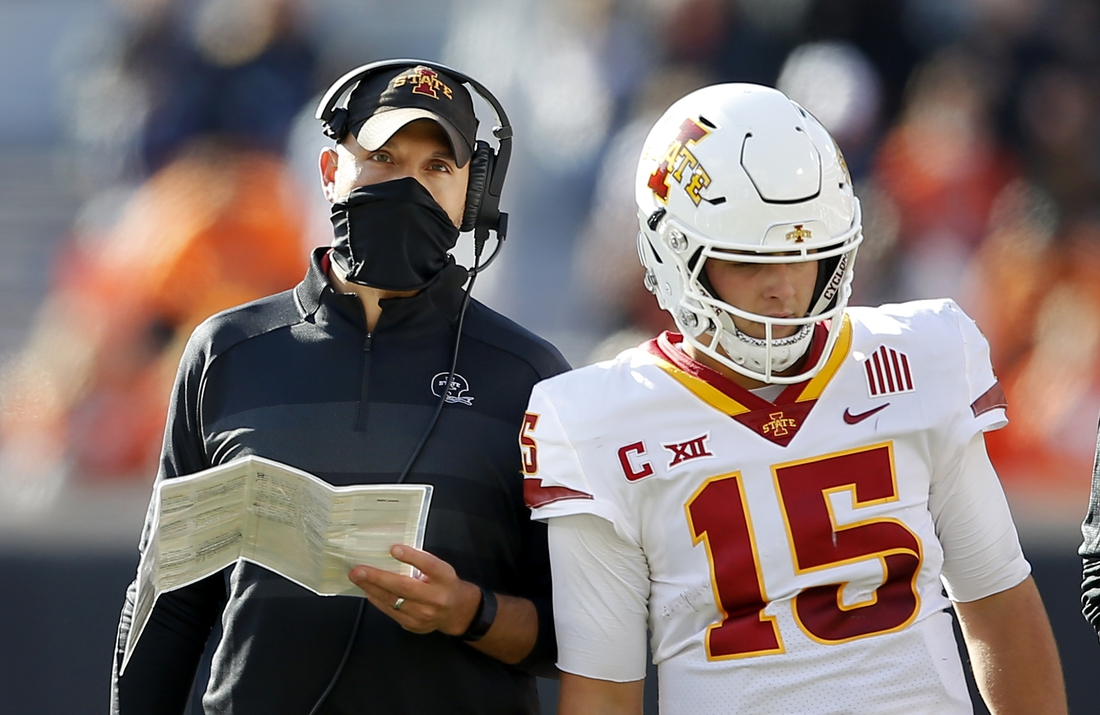 Oct 24, 2020; Stillwater, Oklahoma, USA;  Iowa head coach Matt Campbell talks with quarterback Brock Purdy (15) in a game against Oklahoma State at Boone Pickens Stadium. OSU won 24-21. Mandatory Credit: Sarah Phipps-USA TODAY Sports