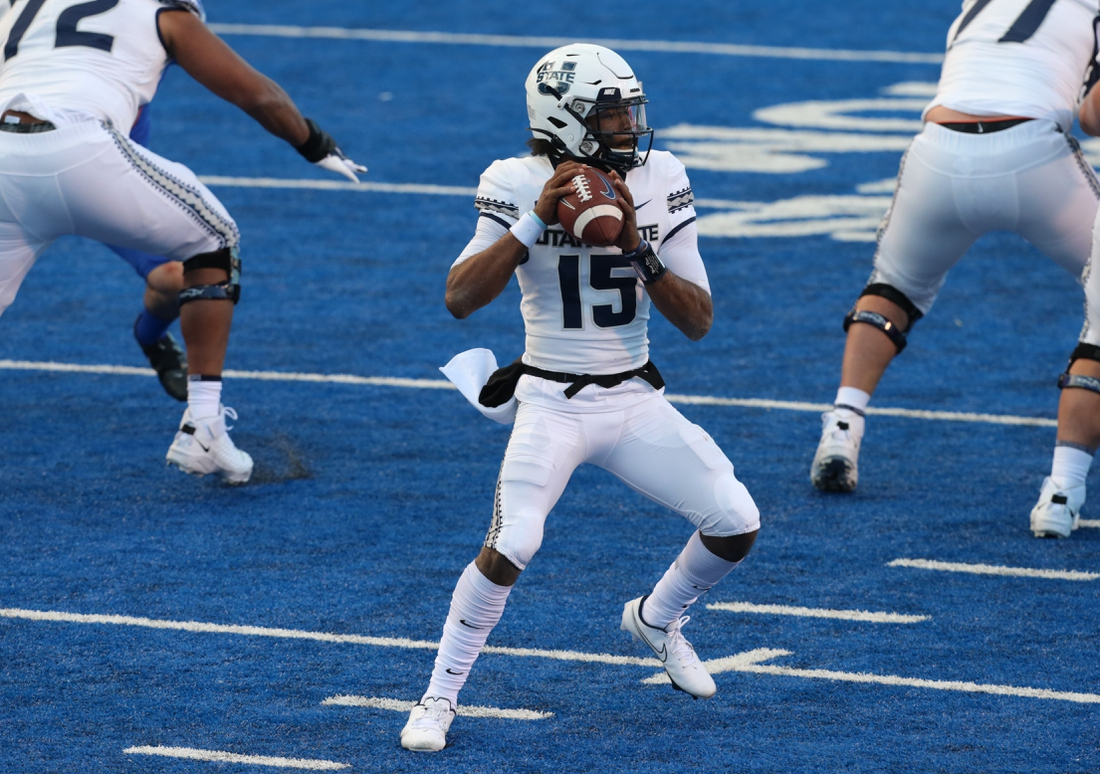 Oct 24, 2020; Boise, Idaho, USA;  Utah State Aggies quarterback Jason Shelley (15) looks for a receiver during the first half versus the Boise State Broncos at Albertsons Stadium. Mandatory Credit: Brian Losness-USA TODAY Sports