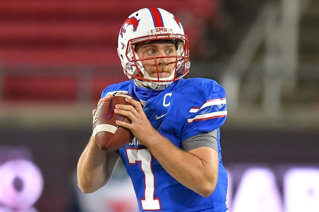 Oct 24, 2020; Dallas, Texas, USA; Southern Methodist Mustangs quarterback Shane Buechele (7) looks down field against the Cincinnati Bearcats during the second half at Gerald J. Ford Stadium. Mandatory Credit: Tim Flores-USA TODAY Sports