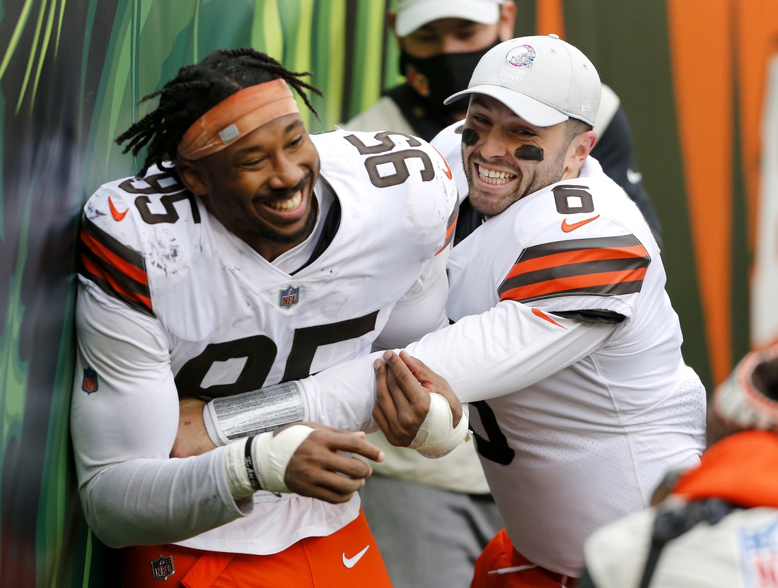 Oct 25, 2020; Cincinnati, Ohio, USA; Cleveland Browns defensive end Myles Garrett (95) and quarterback Baker Mayfield (6) celebrate the come from behind victory in the waning seconds against the Cincinnati Bengals at Paul Brown Stadium. Mandatory Credit: Joseph Maiorana-USA TODAY Sports