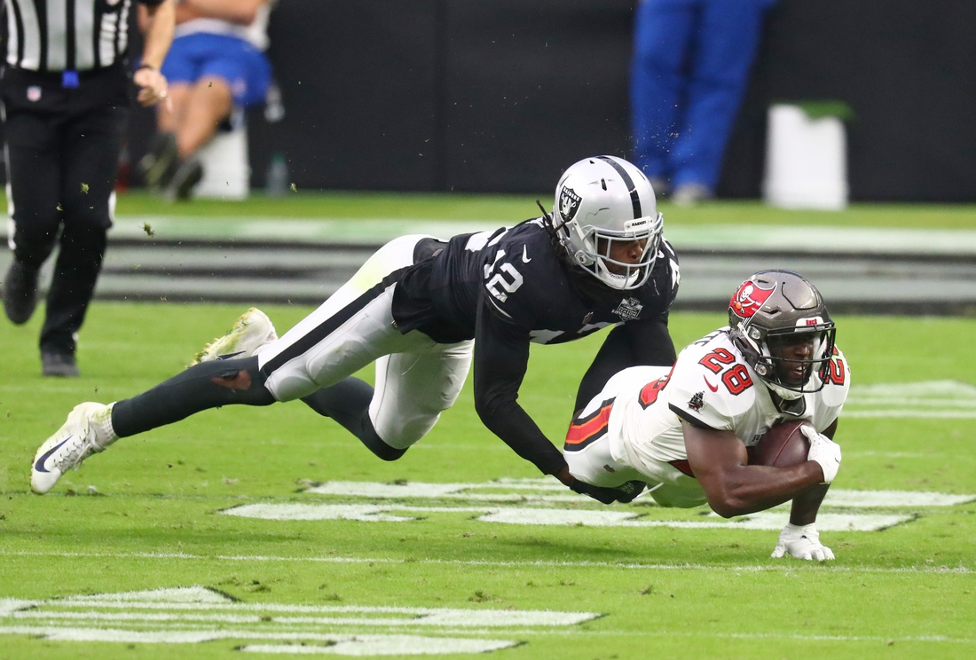 Oct 25, 2020; Paradise, Nevada, USA; Las Vegas Raiders linebacker Cory Littleton (42) tackles Tampa Bay Buccaneers running back Leonard Fournette (28) in the first half at Allegiant Stadium. Mandatory Credit: Mark J. Rebilas-USA TODAY Sports