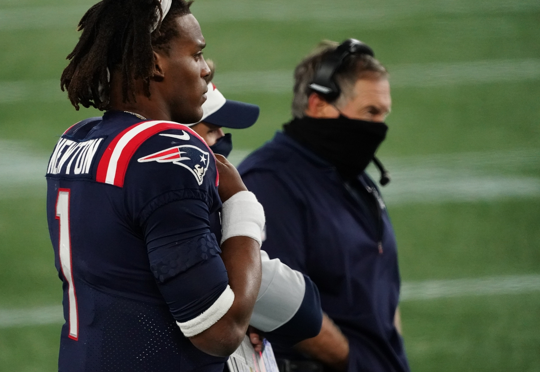 Oct 25, 2020; Foxborough, Massachusetts, USA; New England Patriots quarterback Cam Newton (1) and head coach Bill Belichick look on from the sideline as they take on the San Francisco 49ers in the second half at Gillette Stadium. Mandatory Credit: David Butler II-USA TODAY Sports