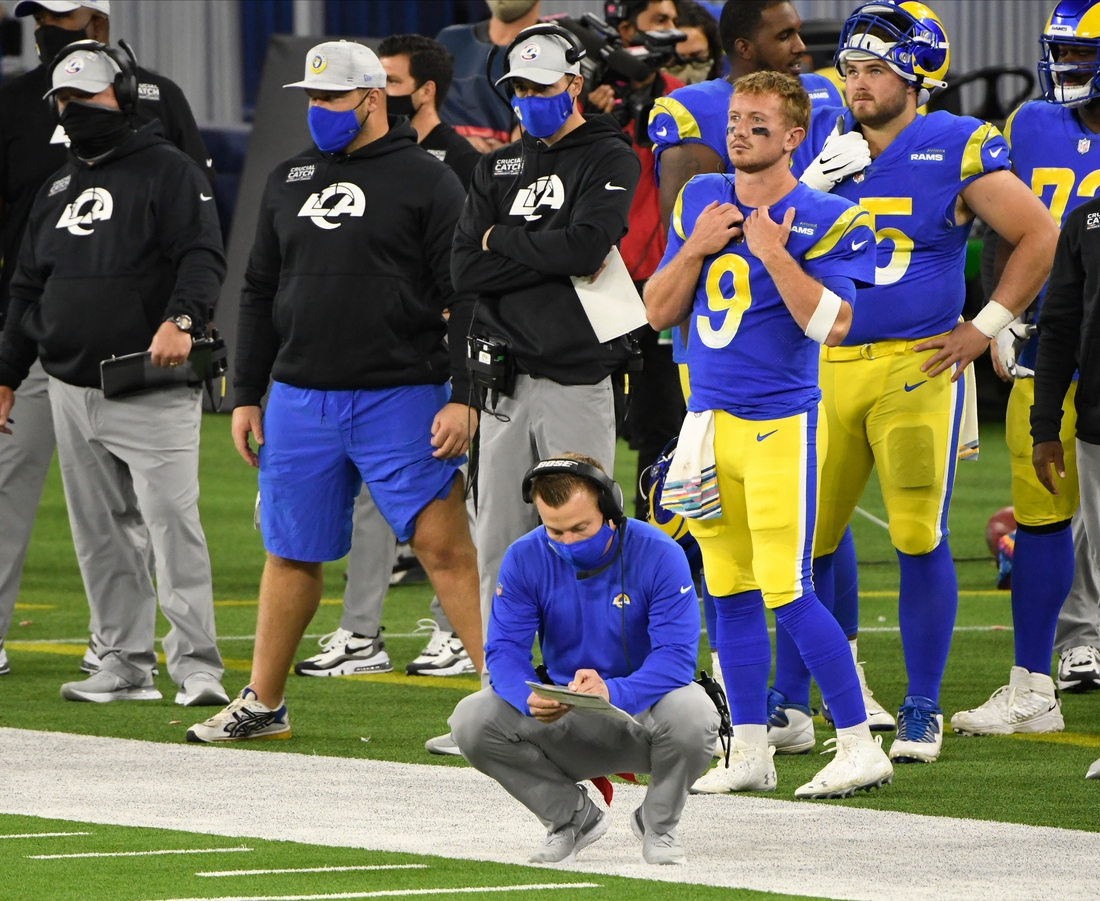 Oct 26, 2020; Inglewood, California, USA; Los Angeles Rams head coach Sean McVay looks over his plays during a timeout in the fourth quarter against the Chicago Bears at SoFi Stadium. Mandatory Credit: Robert Hanashiro-USA TODAY Sports