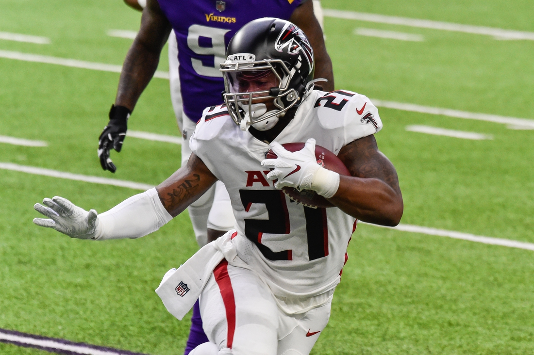 Oct 18, 2020; Minneapolis, Minnesota, USA; Atlanta Falcons running back Todd Gurley (21) in action during the game between the Minnesota Vikings and the Atlanta Falcons at U.S. Bank Stadium. Mandatory Credit: Jeffrey Becker-USA TODAY Sports