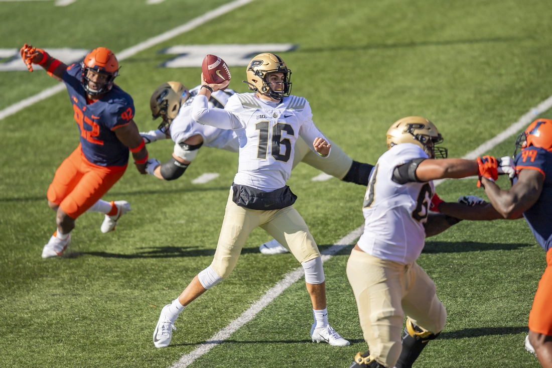Oct 31, 2020; Champaign, Illinois, USA; Purdue Boilermakers quarterback Aidan O'Connell (16) passes against the Illinois Fighting Illini during the first half at Memorial Stadium. Mandatory Credit: Patrick Gorski-USA TODAY Sports