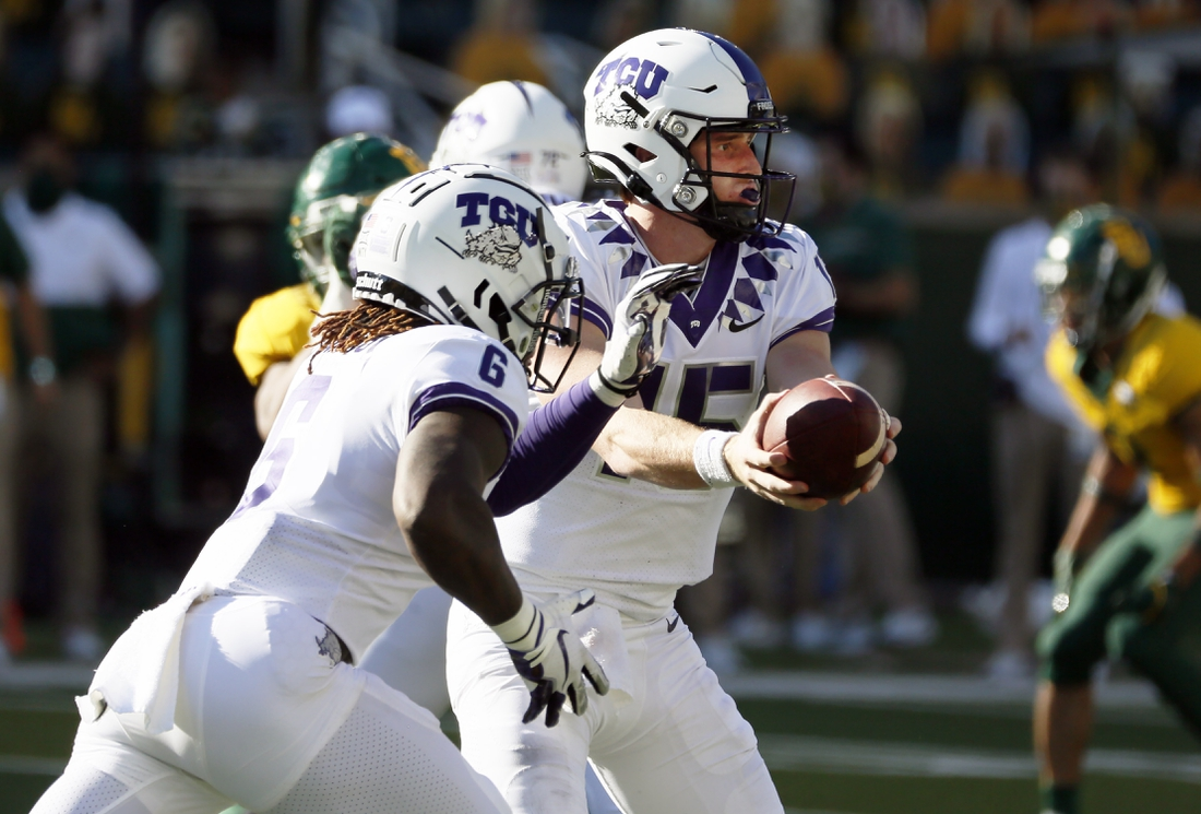 Oct 31, 2020; Waco, Texas, USA; TCU Horned Frogs quarterback Max Duggan (15) hands off to running back Zach Evans (6) during the first half against the Baylor Bears at McLane Stadium. Mandatory Credit: Raymond Carlin III-USA TODAY Sports