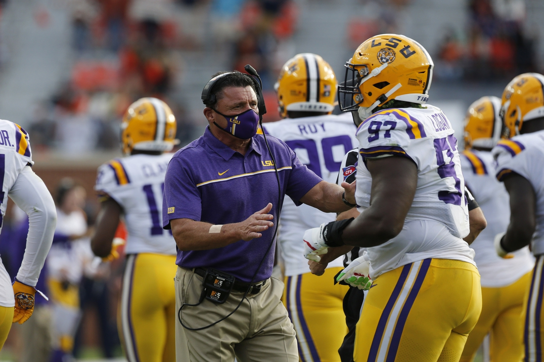 Oct 31, 2020; Auburn, Alabama, USA;  LSU Tigers head coach Ed Orgeron talks to defensive end Glen Logan (97) during the third quarter against the Auburn Tigers at Jordan-Hare Stadium. Mandatory Credit: John Reed-USA TODAY Sports