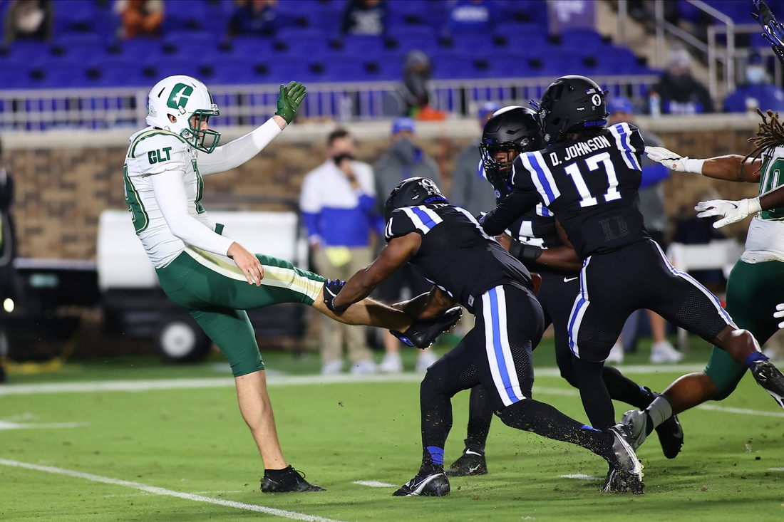 Oct 31, 2020; Durham, North Carolina, USA; Charlotte 49ers punter Connor Bowler (19) has his punt blocked blocked by Duke Blue Devils safety Isaiah Fisher-Smith (11) during the first quarter of the game against the Charlotte 49ers at Wallace Wade Stadium. Mandatory Credit: Jaylynn Nash/Pool Photo-USA TODAY Sports