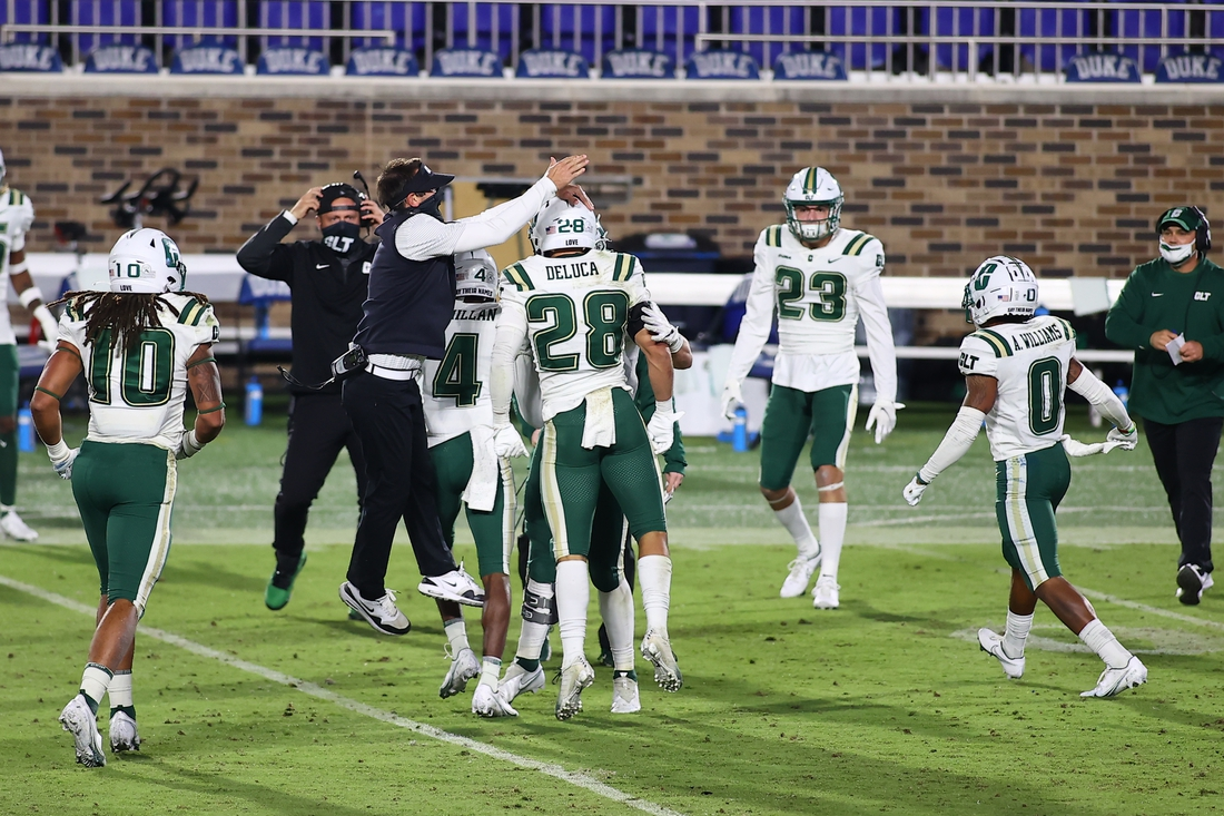 Oct 31, 2020; Durham, North Carolina, USA; Charlotte 49ers head coach Will Healy celebrates a turnover with his players during the first half against the Charlotte 49ers at Wallace Wade Stadium. Mandatory Credit: Jaylynn Nash-USA TODAY Sports