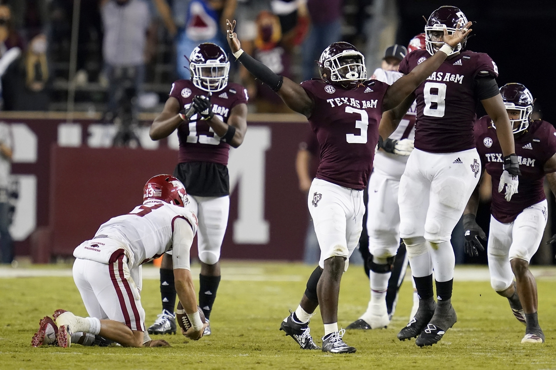 Oct 31, 2020; College Station, TX, USA; Texas A&M defensive lineman Tyree Johnson (3) reacts after sacking Arkansas quarterback Feleipe Franks (13) during the second quarter of an NCAA college football game, Saturday, Oct. 31, 2020, in College Station, Texas. Mandatory Credit: Sam Craft/Pool Photo-USA TODAY Sports