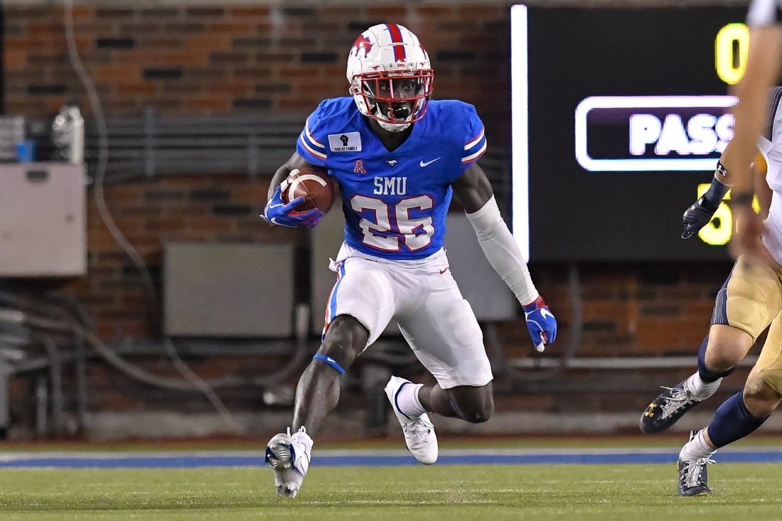 Oct 31, 2020; Dallas, Texas, USA; Southern Methodist Mustangs running back Ulysses Bentley IV (26) runs the ball against Navy Midshipmen during the first half at Gerald J. Ford Stadium. Mandatory Credit: Tim Flores-USA TODAY Sports