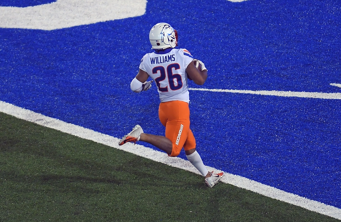 Oct 31, 2020; Colorado Springs, Colorado, USA; Boise State Broncos cornerback Avery Williams (26) scores an eighty eight yard kickoff return in the second half against the Air Force Falcons at Falcon Stadium. Mandatory Credit: Ron Chenoy-USA TODAY Sports