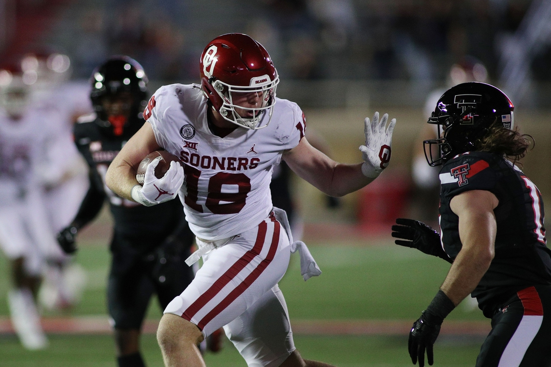 Oct 31, 2020; Lubbock, Texas, USA; Oklahoma Sooners half back Austin Stogner (18) rushes against Texas Tech Red Raiders defensive back Colin Schooler (17) in the first halfat Jones AT&T Stadium. Mandatory Credit: Michael C. Johnson-USA TODAY Sports