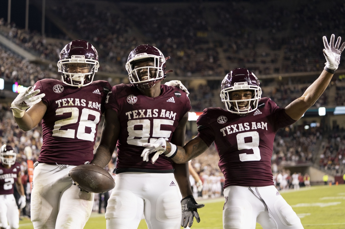 Oct 31, 2020; College Station, TX, USA; Texas A&M tight end Jalen Wydermyer (85) reacts with teammates Isaiah Spiller (28) and Hezekiah Jones (9) after a touchdown catch against Arkansas during the second half of an NCAA college football game, Saturday, Oct. 31, 2020, in College Station, Texas. Mandatory Credit: Sam Craft/Pool Photo-USA TODAY Sports