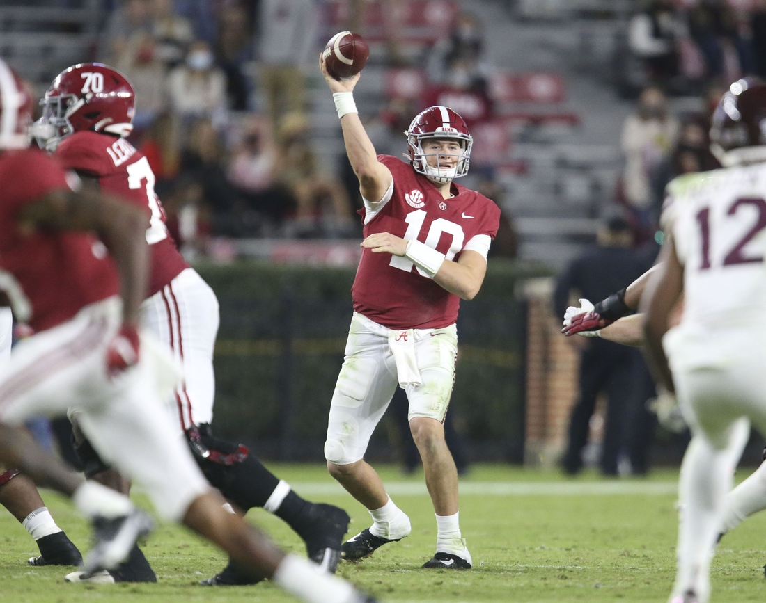 Oct 31, 2020; Tuscaloosa, Alabama, USA;  Alabama quarterback Mac Jones (10) throws a pass at Bryant-Denny Stadium during the second half of Alabama's 41-0 win over Mississippi State. Mandatory Credit: Gary Cosby Jr/The Tuscaloosa News via USA TODAY Sports
